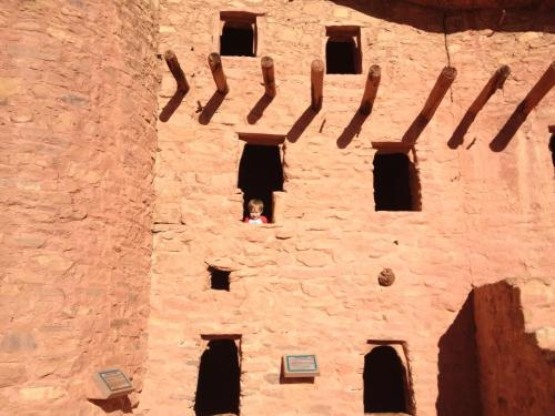 Can you spot the baby in the cliff dwellings?